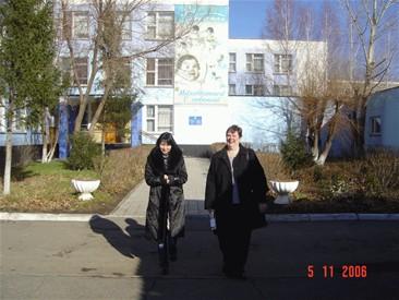alfiya and I outside babyhouse